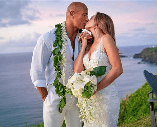 dwayne johnson kisses his newlywed bride lauren hashian.